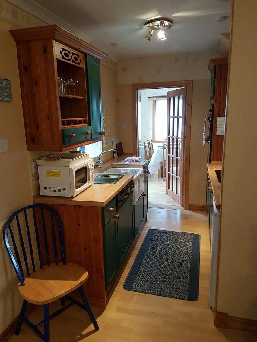 Galley Kitchen leading to Dining